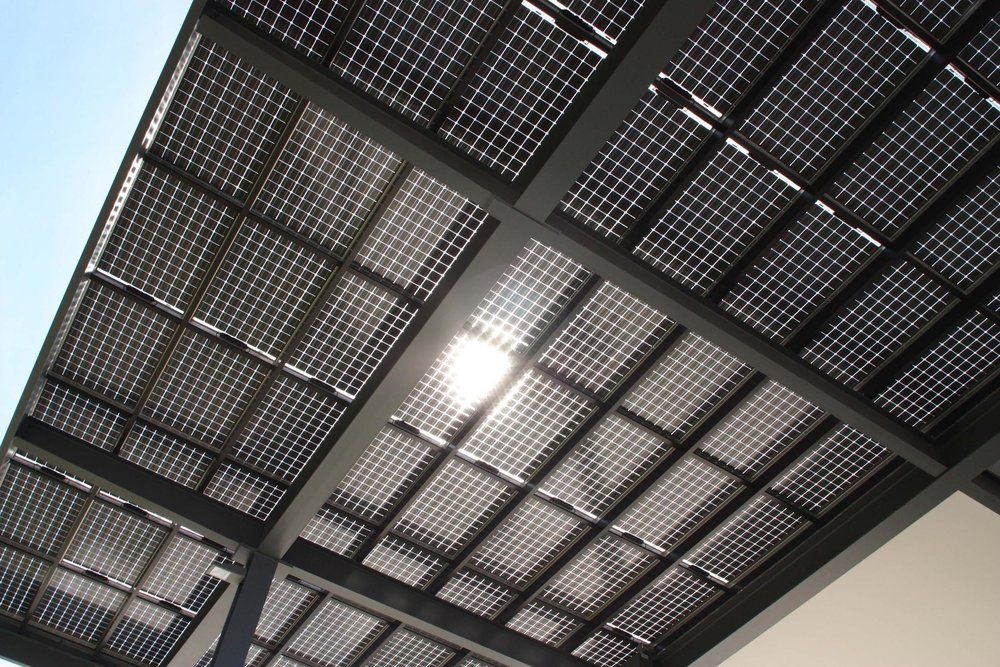 Bifacial (see through) solar module carports